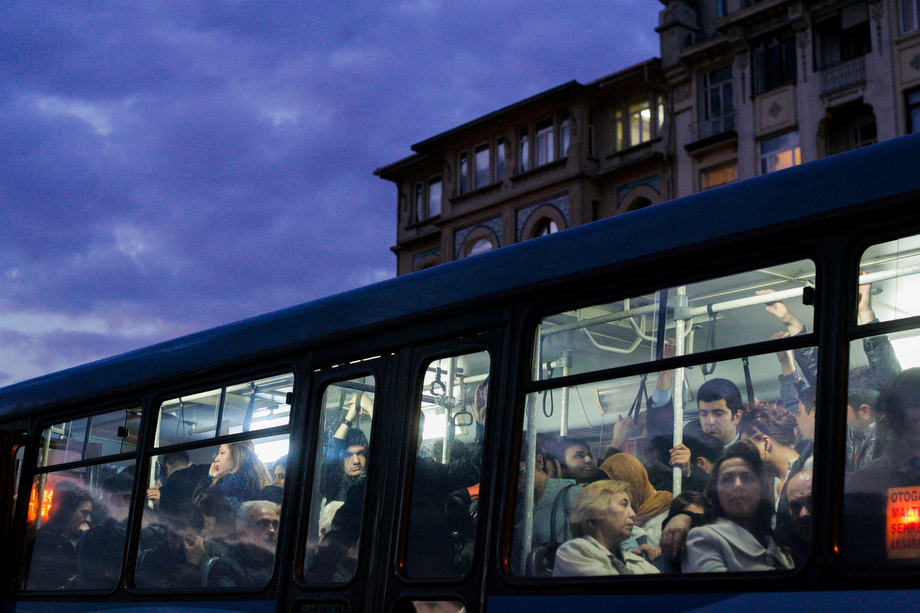 People travel on a public bus in Istanbul.