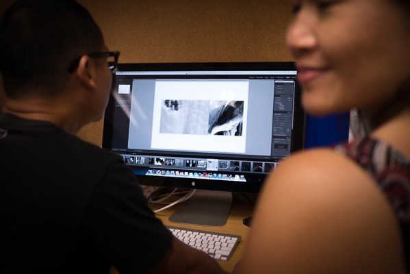Ho Chii Fei assisting with book prints using the Epson Stylus Pro 3885 Printer.