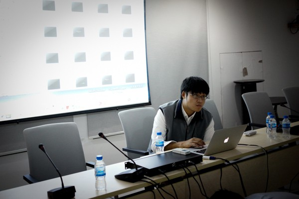 Curator Wang Xi assisting with the slideshow setup for our Southeast Asia Showcase.