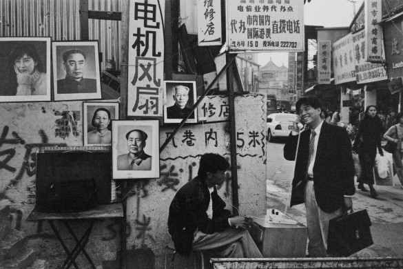A man making a phone call at Luohu Street. 1990 © Yu Haibo
