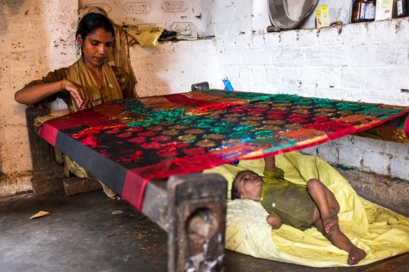 For 30 cents a day, Rukhsana spends hours on end laboring to finish an already woven saree, as her fourth child, also malnourished entertains himself.