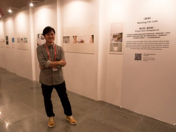 Zeng Liwei at the exhibition of his Mentorship Project at the China-ASEAN Photography Festival in Nanning China.