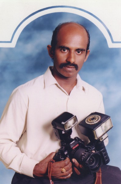 Portrait of Sajeev with his Nikon F4 Kit, circa 1995.