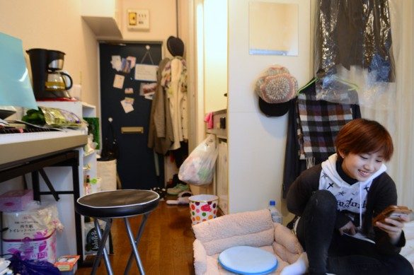 Yen, South Korea. In contrast, Yen's room is packed with her belongings, an accumulation of her life built here. She keeps herself occupied by cooking and playing the keyboard. It's not always done alone - friends sometimes come over for a cosy meal.