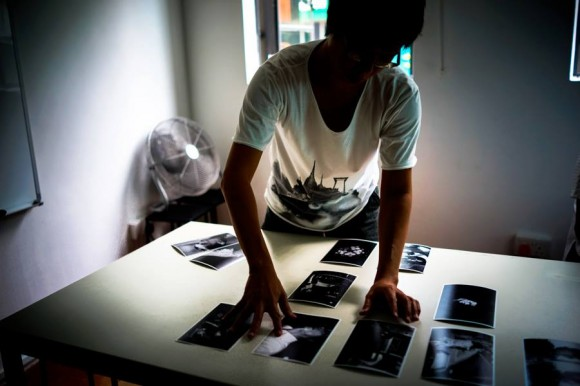 SE Asia Curator Zhuang Wubin editing Christian Lam's photographs.