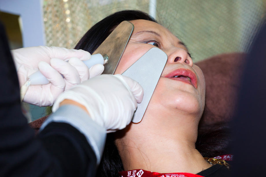 The Cosmetics Show 01: A lady receives a trial of facial treatment at the Cosmetics Show in Hong Kong.