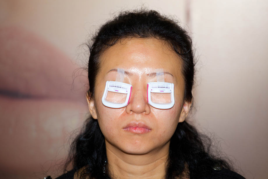 The Cosmetics Show 05: A woman receives her treatment on eyelashes at the Cosmetics Show in Hong Kong.