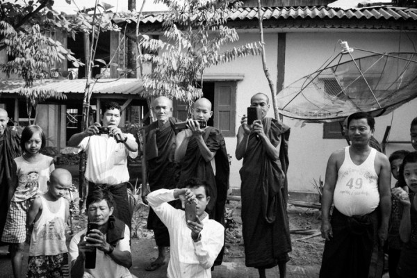 Returning the favour. Monks and villagers near Danyingon Station photograph us back.
