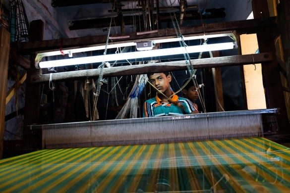Asim Ali, 15, earns less than a dollar a day as a hired laborer. He has never been to school.