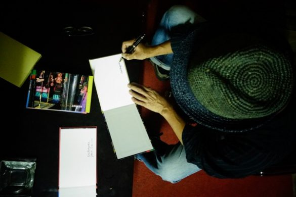 Erik Prasetya signing Street Photo in May, 2014.