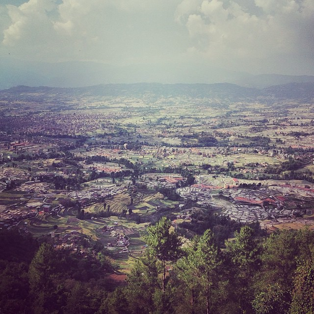 Photo: The valley of Bhaktapur. Some breathing space amidst all these visuals of devastation.  Growing up in Kathmandu was magical. At the time, literally a small quaint Kingdom. A home with a small cow shed and an orchard in the backyard. A larger than life tree towering over an old temple, stretching it's long arms over the entire neighbourhood. At dawn the sounds of brobdingnagian temple bells, struck loud enough to invoke the gods from their sleep. All that against the backdrop of a cacophony of the zillion birds that lived on this tree. Giant wheel chariots, living goddesses and royal processions. The infamous Titaura (local sweet and spicy candy) for which would endeavour any Everest. Demons and Yeti's were still real and come autumn, the breeze would fill the skies with kites. Not a day went by without adventure. Photo by @sumitdayal