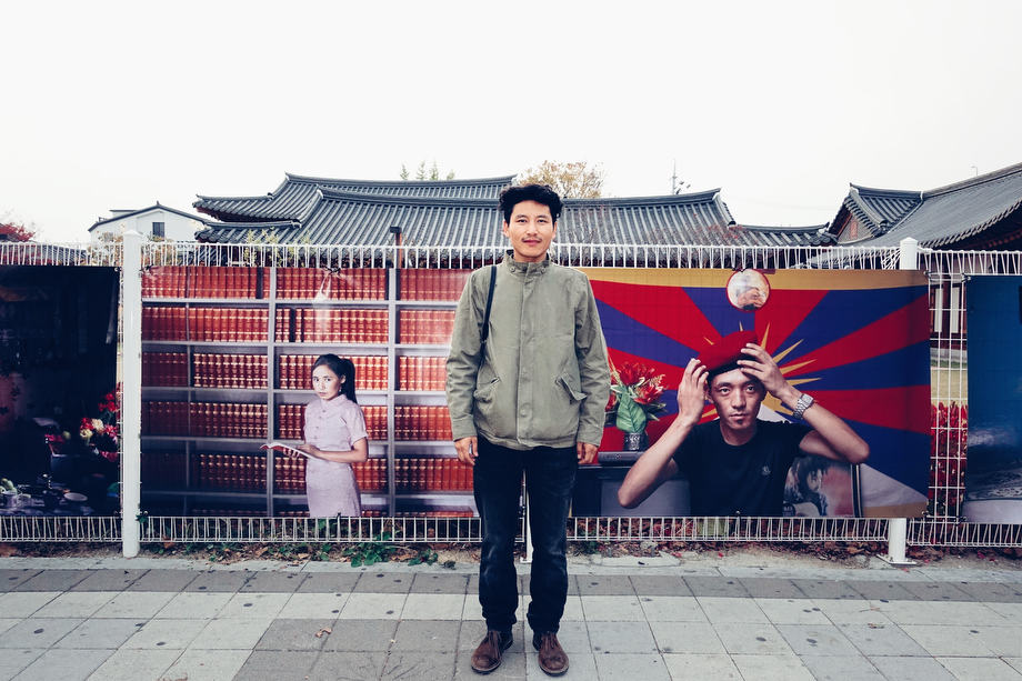 Tsering Topgyal at his 'Tibetans in Exile' exhibition at Suwon International Photo Festival.