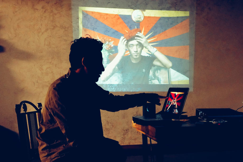 Tsering Topgyal at his artist talk presenting 'Tibetans in Exile'.