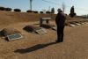 Fr. Daniel O'Keeffe at the graves of Late priests.