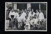 A group photo of my mom's family with the priest after the baptistm ceremony in Young-san-po Church in 1955. My mom, on the priest's lap, was also baptized on the same date with the other family members.